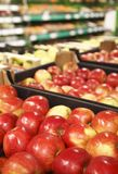 Appetizing red apple in supermarket Stock Image
