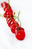 Appetizing red cherries row Royalty Free Stock Images