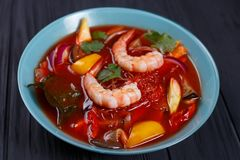 Appetizing red curry soup with prawns and rice noodles,close up. Pan-Asian, thai food, oriental cuisine, food background Stock Photos