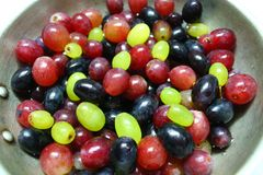 Fruit on dessert. Appetizing ripe sweet colorful juicy grapes fruit for dessert with drops of water on stock image