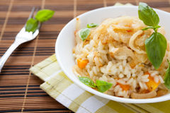 Appetizing risotto with vegetables in white bowl royalty free stock images