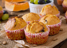 Appetizing and ruddy muffins with pumpkin Royalty Free Stock Photo