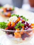 Appetizing salad in a transparent salad bowl Stock Photos