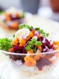 Appetizing salad in a transparent salad bowl Stock Photos