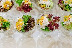 Appetizing salad in a transparent salad bowl, food closeup Royalty Free Stock Photo