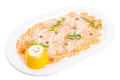 Appetizing salmon carpaccio with arugula. Royalty Free Stock Image