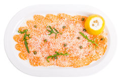Appetizing salmon carpaccio with arugula. Stock Photography