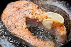 Appetizing salmon steak on a frying pan Stock Photo