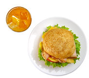 Appetizing sandwich and glass of orange juice Stock Photography