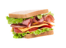 Appetizing sandwich with ham and cheese. Royalty Free Stock Images