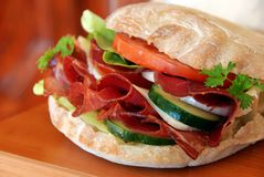 Appetizing sandwich with ham and vegetables Stock Photos