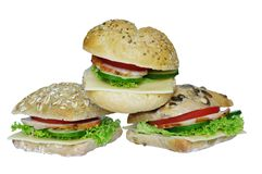 Appetizing sandwiches. Photo three appetizing sandwiches on white background Royalty Free Stock Photography