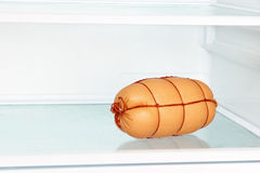 Appetizing sausage on refrigerator shelf. Stock Image