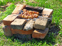 Appetizing  shashlik is preparing on barbecue. Royalty Free Stock Photos