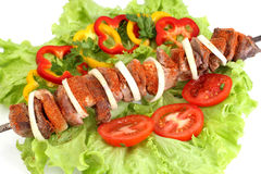 Appetizing shish kebab. With tomatoes and greens Royalty Free Stock Image