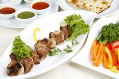 Appetizing Shish Kebab With Tomatoes And Greens Royalty Free Stock Image