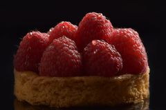 Appetizing shortcake with large raspberries stock images