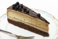 Appetizing slice of sponge cake on a plate closeup. Royalty Free Stock Photos