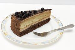 Appetizing slice of sponge cake on a plate closeup. Stock Photography