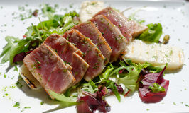 Appetizing slightly roasted tuna with salad Stock Photos