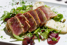 Appetizing slightly roasted tuna on  a salad Royalty Free Stock Image