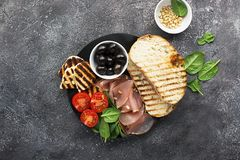Appetizing snack with fried cheese haloumi, olives, bruschetta, tomatoes, olives, pine nuts, olive oil, honey and. Appetizing snack with fried cheese haloumi Royalty Free Stock Photos