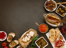 Appetizing Tapas on Table with Copy Space. Assorted Appetizing Tapas on Top of slate Table with Copy Space on Upper Left Side Stock Photos