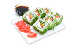 Appetizing tasty Japan rolls on a plate on a white background. Royalty Free Stock Image