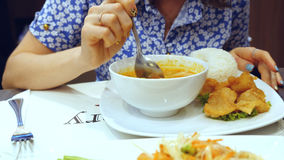 Appetizing and tasty meal of woman in thai cafe. Rice soup and papaya salad Stock Images