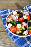 Appetizing vegetable salad with olives and cheese Stock Photos