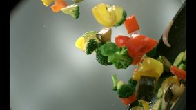 Appetizing vegetables fry in a frying pan. stock video
