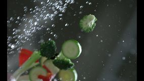 Appetizing vegetables are washed under running water in a colander. Slow motion. Very beautiful studio shot. Slow motion. Camera P. Hantom Flex 4K stock footage
