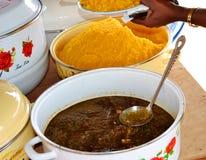 An appetizing view of the dining table. Le fameux `Cococha`, qui signifie foufou chez les Ébriés, spécialité du peuple Atchan, préparé d`une royalty free stock photos