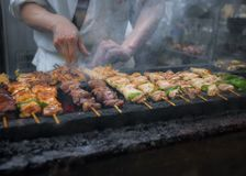 Appetizing Yakitori, Grilled chicken skewers in Tokyo, Japan. Appetizing Yakitori, Grilled chicken skewers in Tokyo, Japan, Typical street food Royalty Free Stock Image