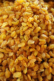 Appetizing yellow dried raisins. A lot of mouth-watering yellow raisins, dried white grapes Stock Photos