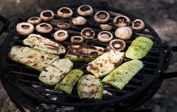 Appetizing zucchini and mushroom bake barbecue Stock Photo