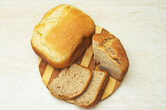 Appetzing sliced homemade bread on table Royalty Free Stock Images
