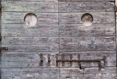 Appignano Marches, Italy, old door. Appignano Ancona, Marches, Italy, buildings of the historic village: old wooden door with rusty sliding lock Royalty Free Stock Image
