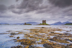 APPIN, SCOTLAND - AUGUST 14 2015 : Castle Stalker in the rain Stock Photography