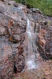 Applådera vattenfallet i Acadianationalpark, Maine Arkivfoto