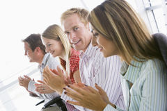 applauding business four indoors people smiling Στοκ φωτογραφία με δικαίωμα ελεύθερης χρήσης
