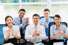 Applauding business people. Cheerful business people applauding at the business conference Royalty Free Stock Image