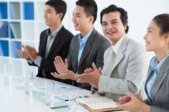 Applauding businessman Stock Photo