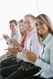 applauding businesspeople four indoors smiling Στοκ φωτογραφίες με δικαίωμα ελεύθερης χρήσης
