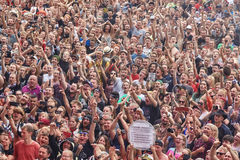 Applauding crowd at the 23rd Woodstock Festival Poland opening ceremony. Kostrzyn, Poland - August 03, 2017: Applauding crowd at the 23rd Woodstock Festival Royalty Free Stock Photos