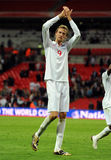 Applauding Peter Crouch. Peter Crouch applauds supporters after England - Belarus 2010 FIFA World Cup Qualifiers match Stock Photos
