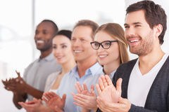 Applauding to corporate innovations. Royalty Free Stock Image