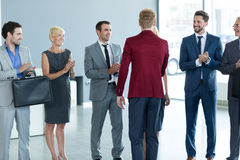Applause business partners and handshaking with leader Stock Image