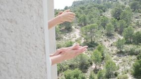 Applause for medical staff. Family applauding, clapping hands on balconies and windows in support of health workers