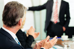 Applause for a presentation in meeting. It was successful royalty free stock images